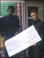 Daddy G and 3D with their cheque for £30,000